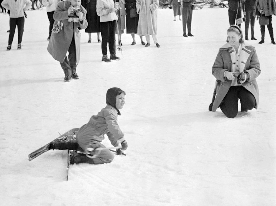 <p>Ingrid Bergman and her daughter, now famous actress Isabella Rossellini, play in the snow while spending Christmas in Sun Valley, Idaho. </p>
