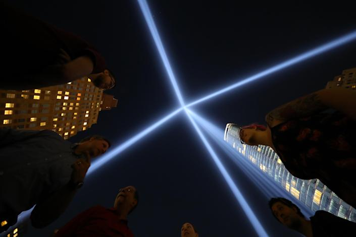 <p>Visitors stand inside the square comprising 44 lights that make up one tower of the Tribute in Light on Sept. 5, 2018. (Photo: Gordon Donovan/Yahoo News) </p>
