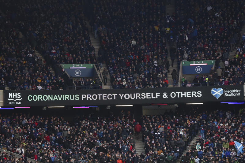 "A message that reads: ""Coronavirus protect yourself and others"" is displayed during the Six Nations rugby union international match between Scotland and France at the Murrayfield stadium in Edinburgh, Scotland, Sunday, March 8, 2020. (AP Photo/Scott Heppell)"