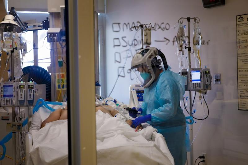 Wearing a PAPR PPE, Kristen Wilson, RN checks on a COVID-19 patient at El Centro Regional Medical Center on June 10th, 2020.