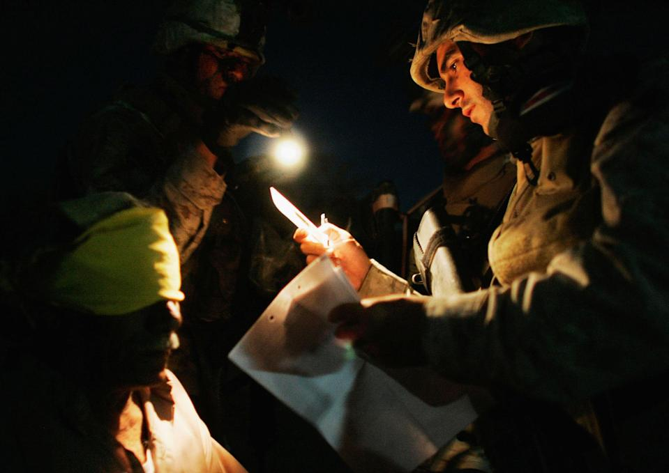 <p>Marines of the Third Battalion, Fourth Marines, process a detained man June 24, 2005 near Fallujah, Iraq. Marines in the 3/4 launched the midnight raid in the rural suburbs of Fallujah and detained 19 men, the Marines said. (Photo by Chris Hondros/Getty Images) </p>