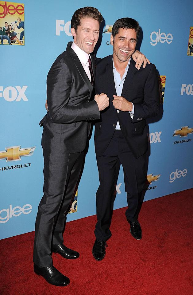 "Matthew Morrison and guest star John Stamos -- who will play Mr. Schu's romantic competition for Emma (Jayma Mays) -- made for a dapper duo. Steve Granitz/<a href=""http://www.wireimage.com"" target=""new"">WireImage.com</a> - September 7, 2010"