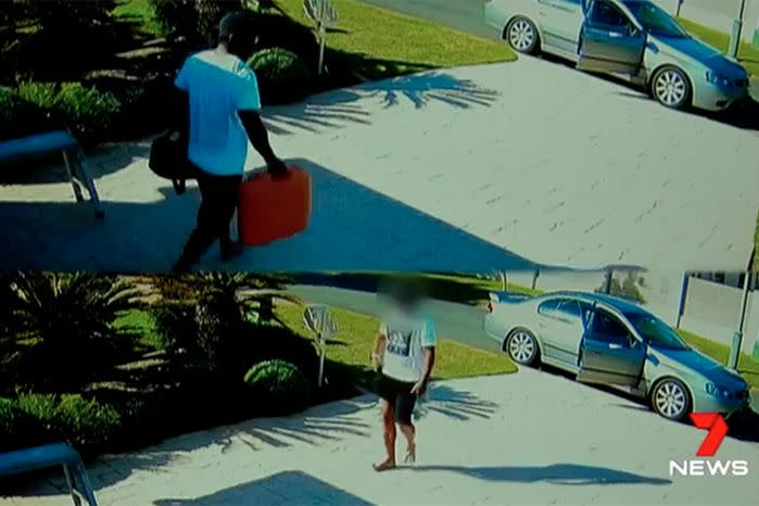 As casually as you like, the thief strolls in and out of the garage twice, loading tools into his stolen getaway car. Source: 7 News