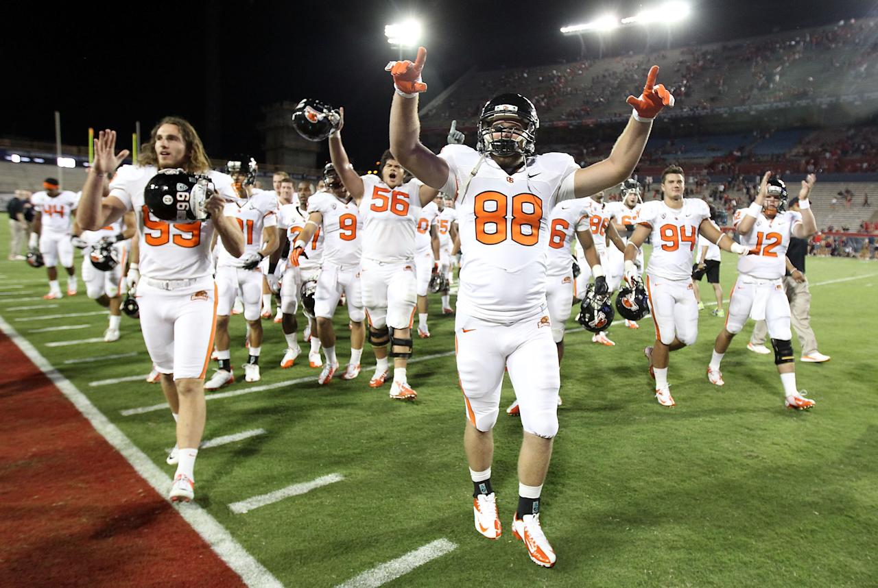 TUCSON, AZ - SEPTEMBER 29:  Tight end Tyler Perry #88 of the Oregon State Beavers celebrates with teammates after defeating the Arizona Wildcats in the college football game at Arizona Stadium on September 29, 2012 in Tucson, Arizona.  The Beavers defeated the Wildcats 38-35. (Photo by Christian Petersen/Getty Images)