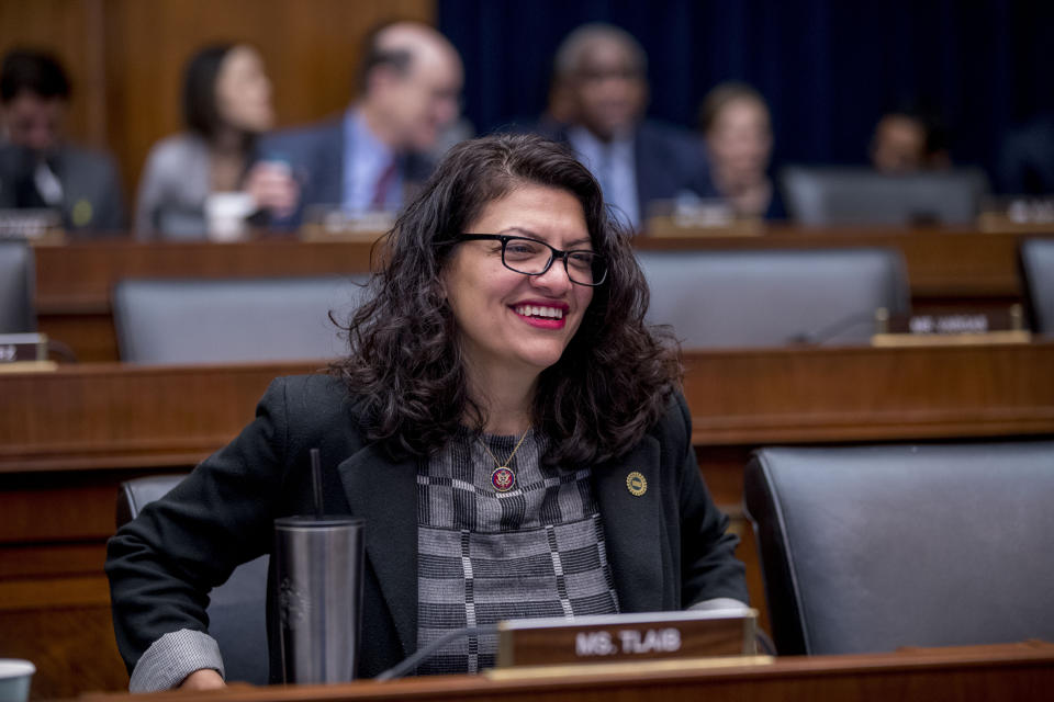 Rep. Rashida Tlaib, D-Mich., appears before Facebook CEO Mark Zuckerberg arrives for a House Financial Services Committee hearing on Capitol Hill in Washington, Wednesday, Oct. 23, 2019, on Facebook's impact on the financial services and housing sectors. (AP Photo/Andrew Harnik)