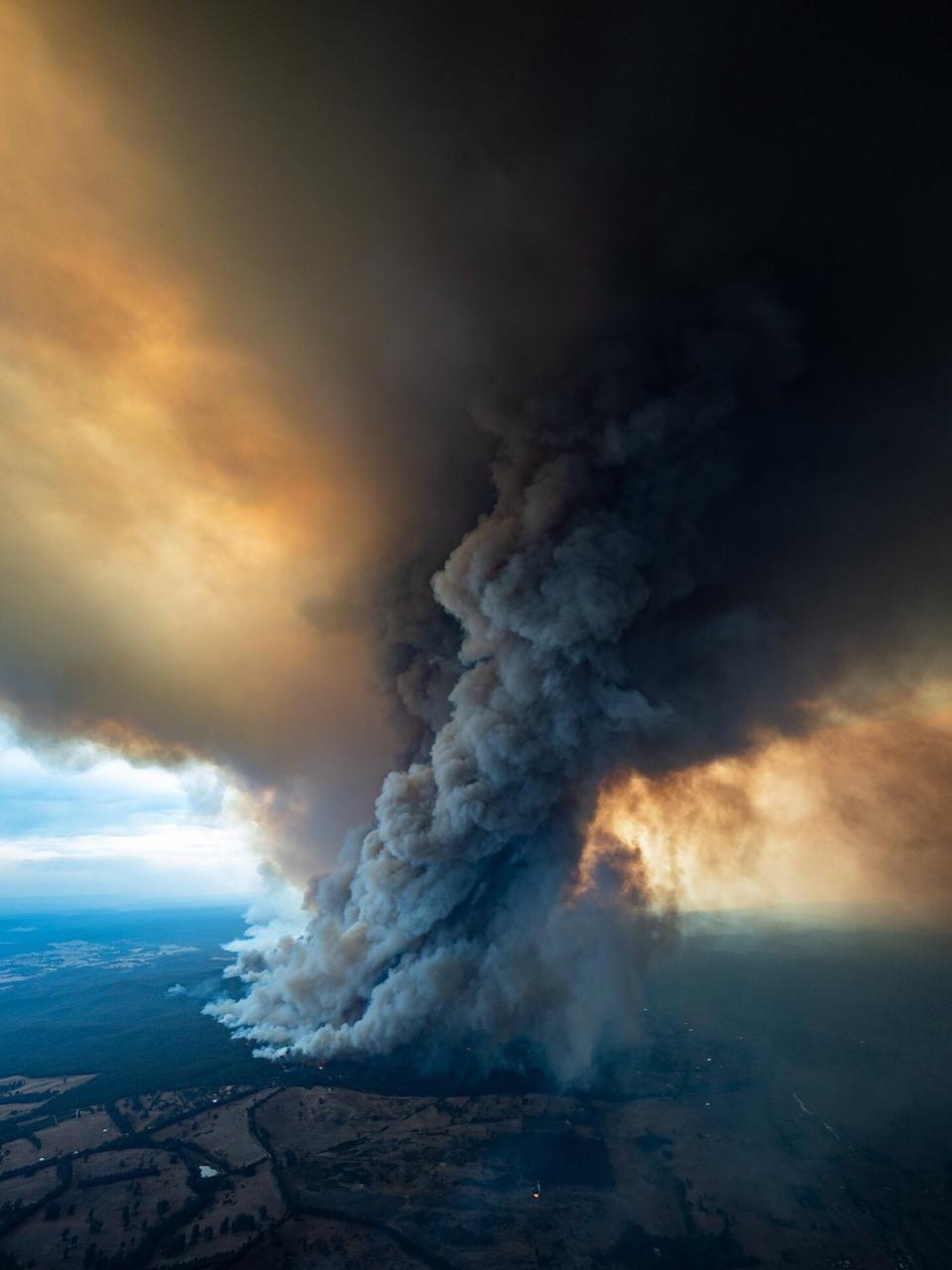 An arial shot shows smoke billowing from a fire burning at East Gippsland, Victoria.