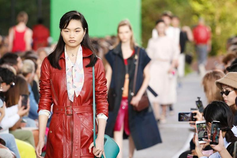 A model in a red leather trench