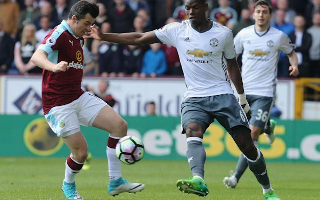 <span>Paul Pogba and Joey Barton challenge for the ball</span> <span>Credit: Getty Images </span>