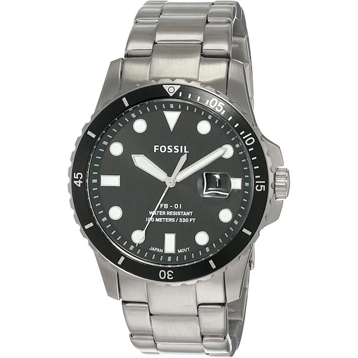 """<p><strong>Fossil</strong></p><p>amazon.com</p><p><strong>$68.98</strong></p><p><a href=""""https://www.amazon.com/dp/B07XYY9X9V?tag=syn-yahoo-20&ascsubtag=%5Bartid%7C10054.g.35351418%5Bsrc%7Cyahoo-us"""" rel=""""nofollow noopener"""" target=""""_blank"""" data-ylk=""""slk:Shop Now"""" class=""""link rapid-noclick-resp"""">Shop Now</a></p><p>Classic diver vibes with a very easy price tag. An easy win if ever there were one.</p>"""