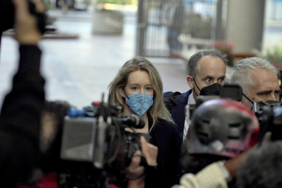 Elizabeth Holmes, founder and CEO of Theranos, arrives at the federal courthouse for jury selection in her trial, Tuesday, Aug. 31, 2021, in San Jose, Calif. Holmes faces 12 felony counts alleging she engineered a massive fraud that duped a litany of rich investors with a blood-testing technology that she promised would be able to screen for hundreds of diseases with a finger prick. (AP Photo/Nic Coury)