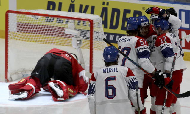 Czech Republic's players, right, celebrate after scoring past Austria's goalkeeper Lukas Herzog, in the goal, during the Ice Hockey World Championships group B match between Austria and Czech Republic at the Ondrej Nepela Arena in Bratislava, Slovakia, Sunday, May 19, 2019. (AP Photo/Ronald Zak)