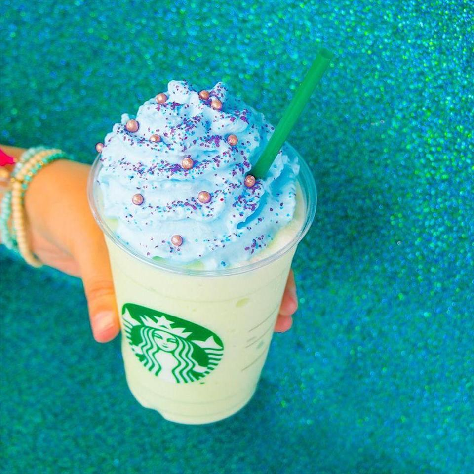 """<p>This <a href=""""https://www.bestproducts.com/buzzing-news/news/a1570/mermaid-frappuccino/"""" rel=""""nofollow noopener"""" target=""""_blank"""" data-ylk=""""slk:pastel drink is green melon crème"""" class=""""link rapid-noclick-resp"""">pastel drink is green melon crème</a> goodness! It's topped with blue vanilla whipped cream, edible pearls, and blue and pink sugar crystals. We think it's fair to say that this one is mermaid-approved!</p>"""