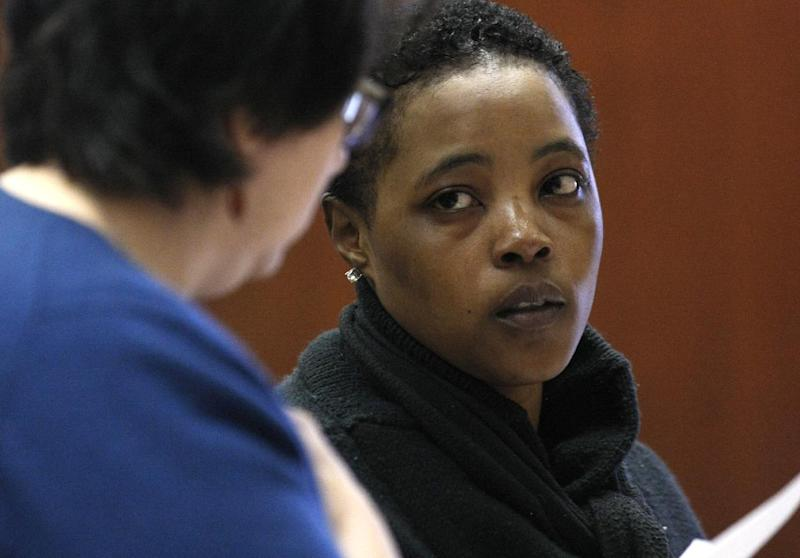 Defense attorney Susan Freedman, left, stands with her client Haniyyah Barnes, Tuesday, April 29, 2014, in Newark, N.J. Barnes admitted killing her neighbor's dog during an argument over a parking space. The Star-Ledger of Newark reports that Barnes pleaded guilty Tuesday to breaking into her neighbor's home, grabbing the 2-year-old Shih Tzu named Honey Bey and throwing the dog into oncoming traffic in August 2011, where she was struck by a vehicle and killed. Barnes will be sentenced July 14. (AP Photo/The Star-Ledger, Patti Sapone)