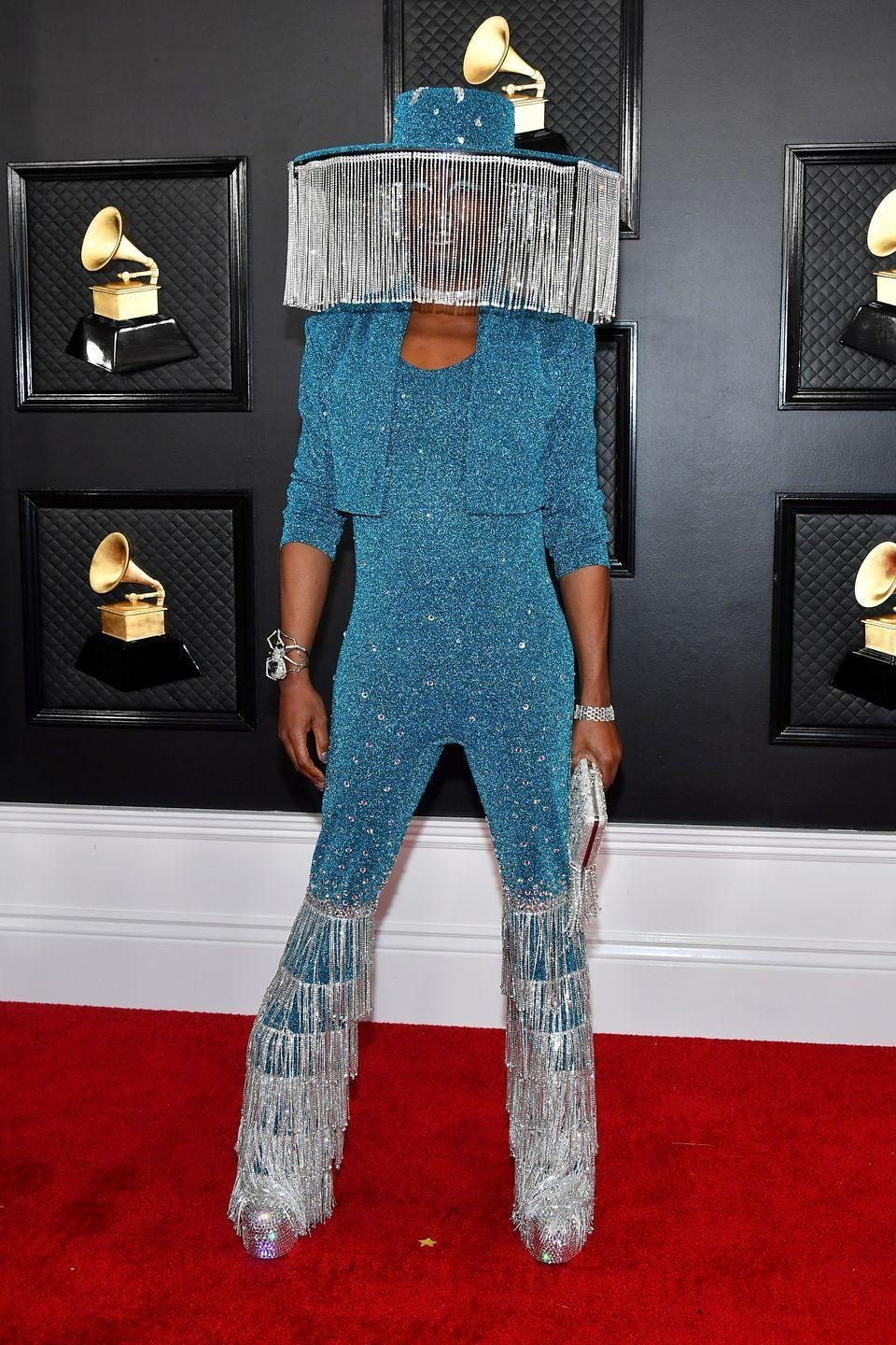 """<p>Perhaps his most figure-hugging look to date, Billy Porter turned up to the <a href=""""https://www.elle.com/uk/fashion/g30672026/grammy-awards-best-red-carpet-looks-dresses/"""" rel=""""nofollow noopener"""" target=""""_blank"""" data-ylk=""""slk:2020 GRAMMY Awards"""" class=""""link rapid-noclick-resp"""">2020 GRAMMY Awards</a> in a custom Baja East blue crystal-encrusted ensemble.</p><p>The actor styled the look with a custom Sarah Sokol hat, designed by Porter, his stylist Ratelle and Scott Studenberg of Baja East.<br></p><p>Big brimmed and motorised, the hat featured peekaboo-style crystal curtains which opened and closed, inspiring memes-a-plenty.</p>"""