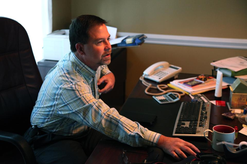 In this Oct. 19, 2012, photo, Ray Arvin poses by his work computer, in Charlotte, N.C. Romney supporter, Arvin used to own a small business with five employees, selling equipment to power companies, but he went out of business in 2009. He's now a salesman for another equipment company. Polls consistently find that the economy is the top concern of voters, and Romney tends to get an edge over Obama when people are asked who might do better with it. Whether that truly drives how Americans vote is a crucial question for Election Day. (AP Photo/Robert Ray)
