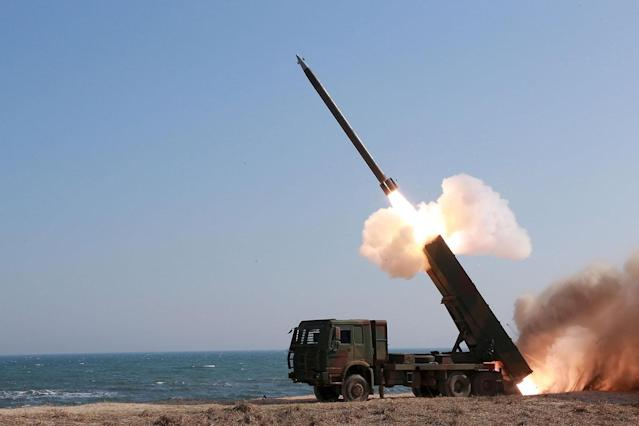 <p>A rocket is launched during a demonstration of a new large-caliber multiple rocket launching system at an unknown location, April 12, 2016. (KCNA/Reuters) </p>