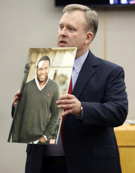 Assistant District Attorney Jason Hermus shows a photo of Botham Jean to the jury during his opening statement before the jury during former Dallas police Officer Amber Guyger''s trial in Dallas, Monday, Sept. 23, 2019. Guyger is accused of shooting Jean, her black neighbor in his Dallas apartment.(Tom Fox/The Dallas Morning News via AP, Pool)