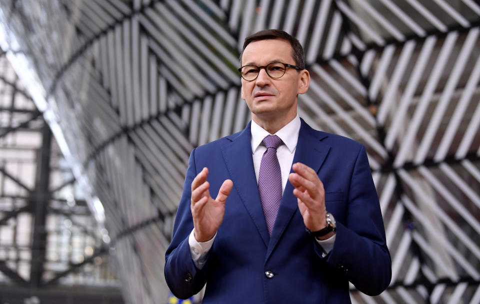 Poland's Prime Minister Mateusz Morawiecki arrives for an EU summit at the European Council building in Brussels, Thursday, Dec. 10, 2020. European Union leaders meet for a year-end summit that will address anything from climate, sanctions against Turkey to budget and virus recovery plans. Brexit will be discussed on the sidelines. (John Thys, Pool via AP)