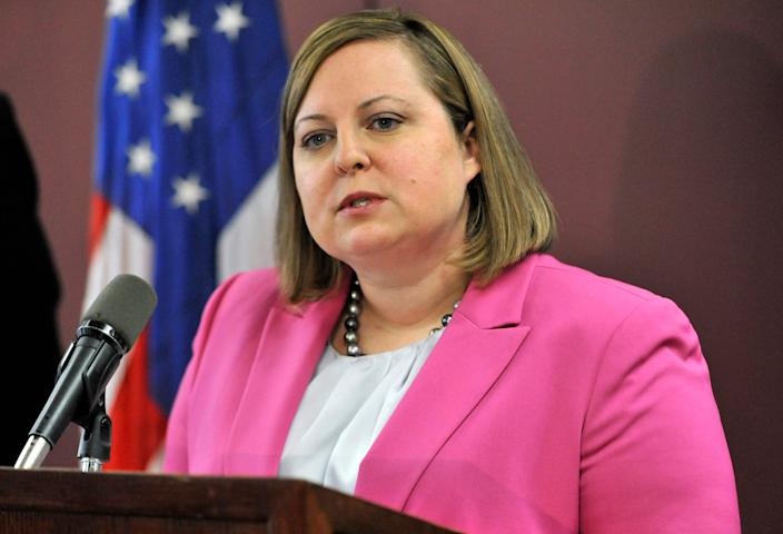 FILE - In this April 29, 2014, file photo, Erin Deveney, interim head of the Massachusetts Department of Children and Families, speaks during a news conference in Boston. Volodymyr Zhukovskyy, a driver for a transport company who has a history of traffic arrests, pleaded not guilty Tuesday, June 25, 2019, to seven counts of negligent homicide in a collision with a group of motorcyclists on a rural highway. His case also led late Tuesday to the resignation of Deveney, the head of the motor vehicle division in Massachusetts, after it was determined Zhukovskyy's commercial driving license should have been suspended following a drunk driving arrest in Connecticut in May. (AP Photo/Josh Reynolds, File)