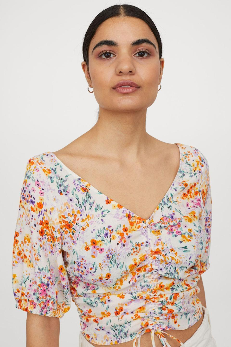 <p>Style this <span>Draped Blouse</span> ($25) with barely-there sandals, white denim jeans and a minimal shoulder bag for a refreshingly cool summer look.</p>