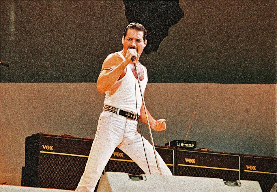 LONDON, UNITED KINGDOM - JULY 13: Freddie Mercury of Queen performs on stage at Live Aid on July 13th, 1985 in Wembley Stadium, London, England (Photo by Pete Still/Redferns)