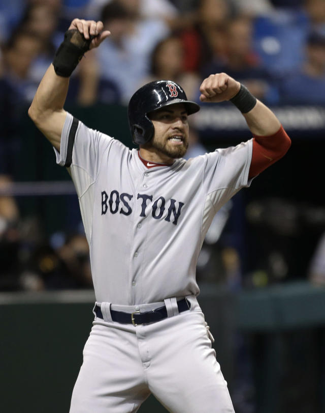 Boston Red Sox center fielder Jacoby Ellsbury (2) reacts as he scores on a single by Shane Victorino in the seventh inning in Game 4 of an American League baseball division series against the Tampa Bay Rays, Tuesday, Oct. 8, 2013, in St. Petersburg, Fla. (AP Photo/Chris O'Meara)