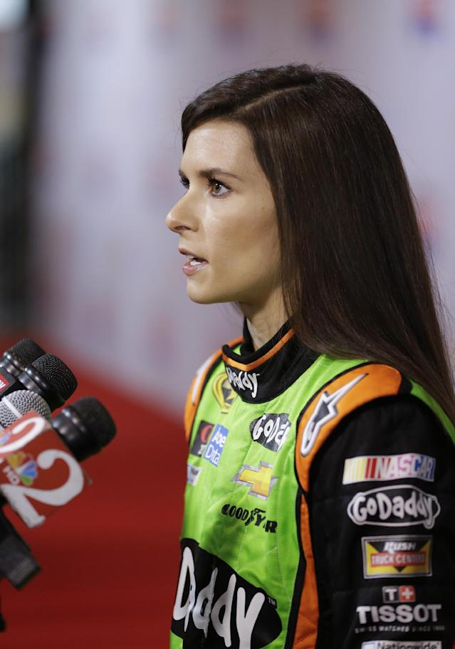 Driver Danica Patrick answers questions during NASCAR auto racing media day at Daytona International Speedway in Daytona Beach, Fla., Thursday, Feb. 13, 2014. (AP Photo/John Raoux)