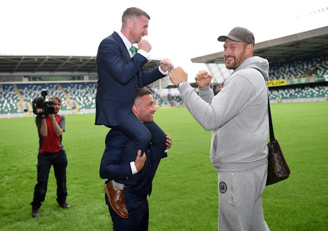Boxing - Carl Frampton & Tyson Fury Press Conference - Windsor Park, Belfast, Britain - June 18, 2018 Tyson Fury, Carl Frampton and Paddy Barnes after the press conference REUTERS/Clodagh Kilcoyne