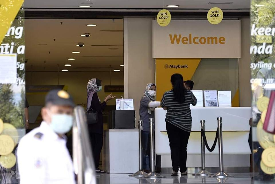 People are seen at a Maybank branch in Shah Alam March 26, 2020. ― Picture by Miera Zulyana