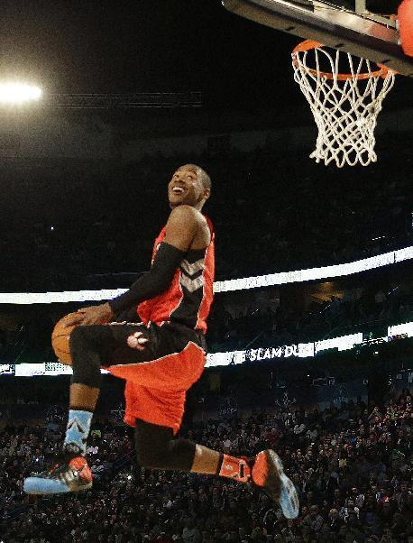 Terrence Ross of the Toronto Raptors participates in the slam dunk contest during the skills competition at the NBA All Star basketball game, Saturday, Feb. 15, 2014, in New Orleans. (AP Photo/Gerald Herbert)