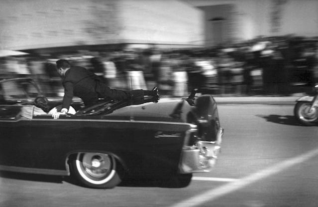 <p>The limousine carrying mortally wounded President John F. Kennedy races toward the hospital seconds after he was shot in Dallas on Nov. 22, 1963. Secret Service agent Clinton Hill is riding on the back of the car, Nellie Connally, wife of Texas Gov. John Connally, bends over her wounded husband, and first lady Jacqueline Kennedy leans over the president. The National Archives has until Oct. 26, 2017, to disclose the remaining files related to Kennedy's assassination, unless President Donald Trump intervenes. (Photo: Justin Newman/AP) </p>