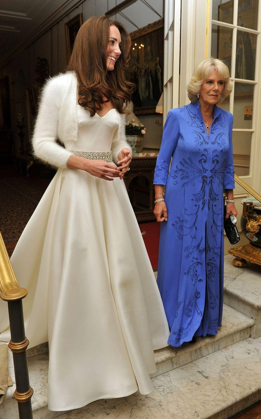 <p>At Prince William and Duchess Kate's wedding reception at Buckingham Palace Camilla sported a long periwinkle gown with cobalt beading. </p>