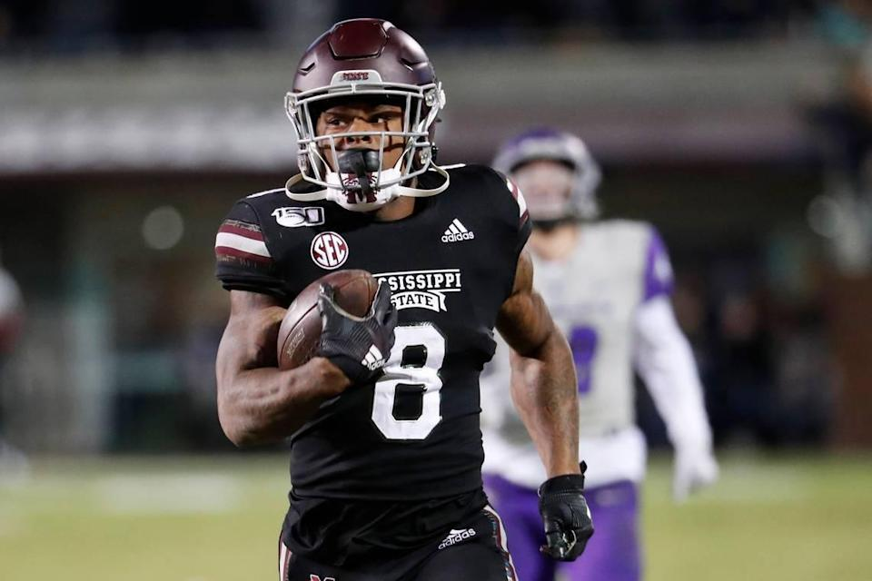 Mississippi State running back Kylin Hill (8) runs past Abilene Christian players on his way to an 88-yard touchdown pass reception during the first half of an NCAA college football game, Saturday, Nov. 23, 2019, in Starkville, Miss. (AP Photo/Rogelio V. Solis)
