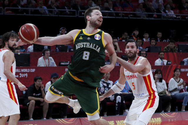 Matthew Dellavedova of Australia tries to pass the ball over Rudy Fernandez of Spain during their semifinals match for the FIBA Basketball World Cup at the Cadillac Arena in Beijing, Saturday, Sept. 13, 2019. (AP Photo/Andy Wong)