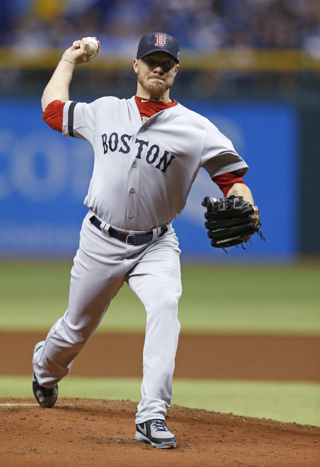 Boston Red Sox starting pitcher Jake Peavy throws in the first inning in Game 4 of an American League baseball division series against the Tampa Bay Rays, Tuesday, Oct. 8, 2013, in St. Petersburg, Fla. (AP Photo/Mike Carlson)