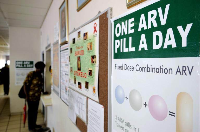 A woman queueing to receive pills that help HIV-positive people from developing AIDS at a clinic north of Johannesburg. South Africa has one of the largest programmes to distribute the life-saving drugs. at the Pharmacy at Phedisong clinic on April 8, 2013 during the launch of the new single dose anti-AIDs drug in Ga-Rankuwa,100 kms north of Johannesburg. The new pill will simplify the world's biggest HIV treatment regime to just one life-saving pill a day. The new single dose AIDS drug was secured at a record-low price and will cost the state 89 rand a month ($10, eight euros) per patient. After years of refusing to roll out ARVs, South Africa now has 1.9 million people on treatment of its 5.6 million HIV-positive population, which is the world's largest. The new pill will be introduced this month to positive pregnant women and breastfeeding mothers, people co-infected with TB, and to new ARV patients. AFP PHOTO / STEPHANE DE SAKUTINA woman queues at the Pharmacy at Phedisong clinic on April 8, 2013 during the launch of the new single dose anti-AIDs drug in Ga-Rankuwa,100 kms north of Johannesburg. The new pill will simplify the world's biggest HIV treatment regime to just one life-saving pill a day. The new single dose AIDS drug was secured at a record-low price and will cost the state 89 rand a month ($10, eight euros) per patient. After years of refusing to roll out ARVs, South Africa now has 1.9 million people on treatment of its 5.6 million HIV-positive population, which is the world's largest. The new pill will be introduced this month to positive pregnant women and breastfeeding mothers, people co-infected with TB, and to new ARV patients. AFP PHOTO / STEPHANE DE SAKUTIN