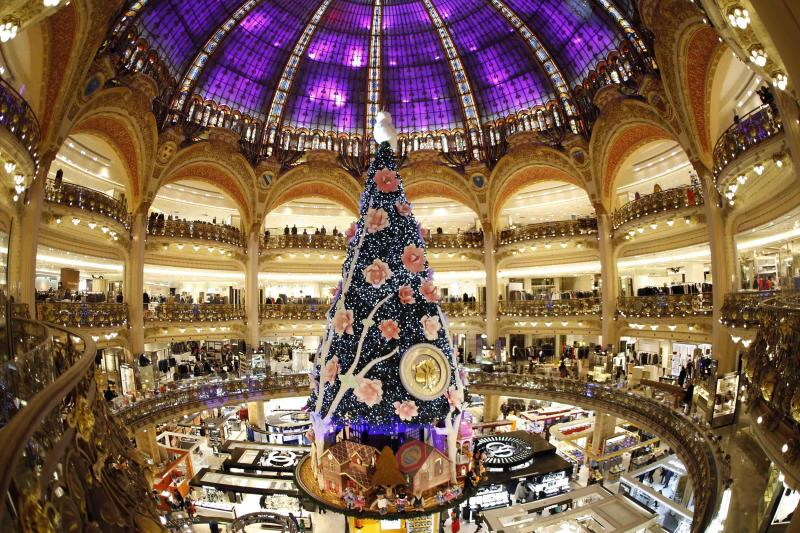 A giant Christmas tree stands in the middle of the Galeries Lafayette department store in Paris ahead of the holiday season in the French capital