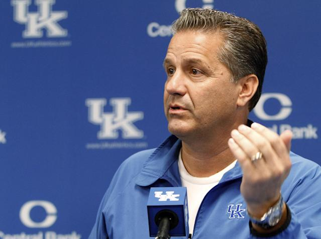 Kentucky coach John Calipari answers a question during the NCAA men's college basketball team's media day in Lexington, Ky., on Tuesday, Oct. 15, 2013. (AP Photo/James Crisp)