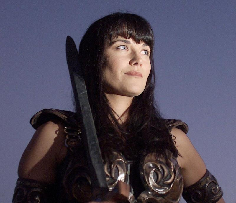 """Actress Lucy Lawless playing the character """"Xena""""while filming for the last episode of """"Xena, the Warrior Princess."""""""