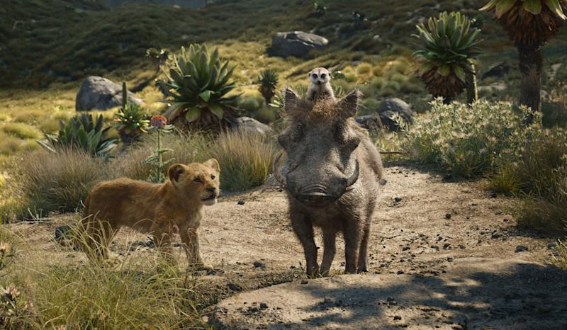 Young Simba (voiced by JD McCrary, left) makes friends with meerkat Timon (Billy Eichner) and warthog Pumbaa (Seth Rogen) in