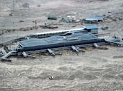 Sendai Airport is surrounded by waters in Miyagi prefecture (state), Japan, after a ferocious tsunami spawned by one of the largest earthquakes ever recorded slammed Japan's eastern coast Friday, March 11, 2011. (AP Photo/Kyodo News)