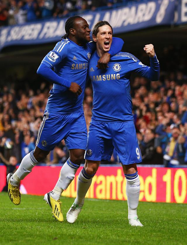 LONDON, ENGLAND - DECEMBER 23: Fernando Torres of Chelsea (R) celebrates with Victor Moses as he scores their first goal during the Barclays Premier League match between Chelsea and Aston Villa at Stamford Bridge on December 23, 2012 in London, England. (Photo by Clive Rose/Getty Images)