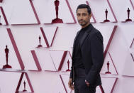 Riz Ahmed arrives at the Oscars on Sunday, April 25, 2021, at Union Station in Los Angeles. (AP Photo/Chris Pizzello, Pool)