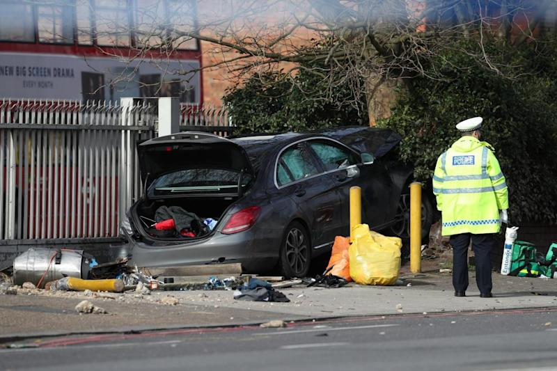 Mercedes: The car was shown crashed into a hedge (PA)