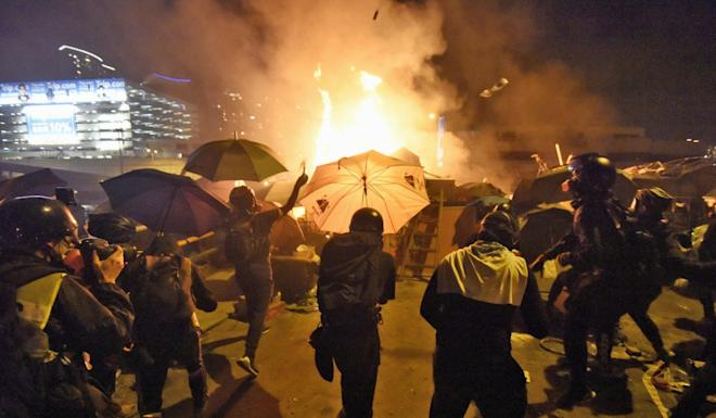 Police declared Sunday's unrest in and around PolyU campus a riot, before starting their siege of the grounds that night. Photo: Kyodo