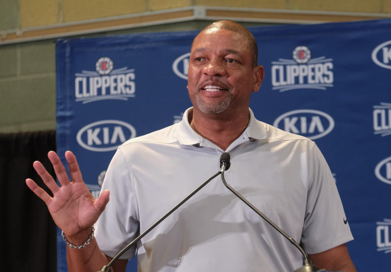 From left, Los Angeles Clippers head coach Doc Rivers introduces Paul George and Kawhi Leonard at a press conference at the Green Meadows Recreation Center in Los Angeles, Wednesday, July 23, 2019. (AP Photo/Ringo H.W. Chiu)