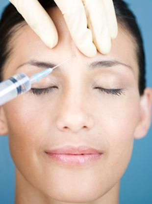 woman getting botox between eyes
