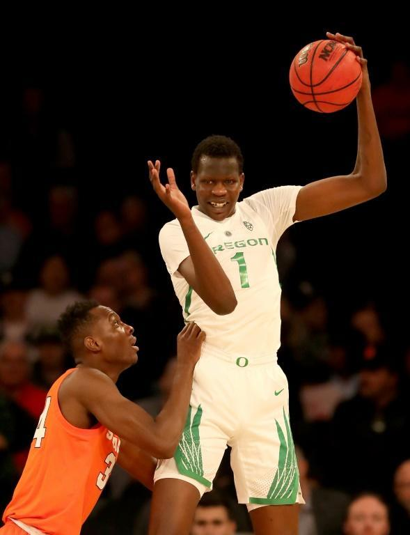 Bol Bol, at right playing for the University of Oregon, grabs the rebound against Syracuse's Bourama Sidibe during a US college basketball game last November in New York (AFP Photo/ELSA)