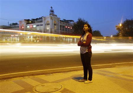 Inayat Naomi Ramdas, 21, poses for a photograph at a busy traffic intersection in New Delhi