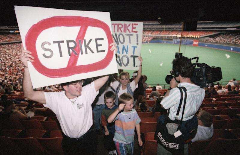 Robert Martinez, left, leads a group of protesters out of the stands after the third inning of the game between the San Diego Padres and the Houston Astros in Houston, on Thursday, August 11, 1994. The Padres beat the Astros 8-6. Major League baseball players are set to strike after the completion of play Thursday. (AP Photo/Rick Bowmer)